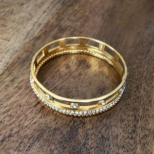 Coach woman's gold bracelet set